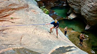 A man doing a trick on a rock