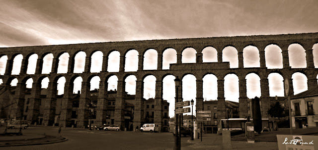 A large building with Segovia in the background