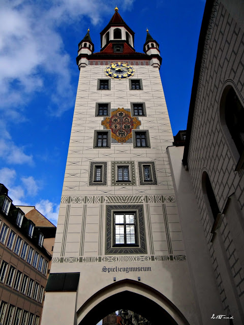 A large tall tower with a clock on the side of a building