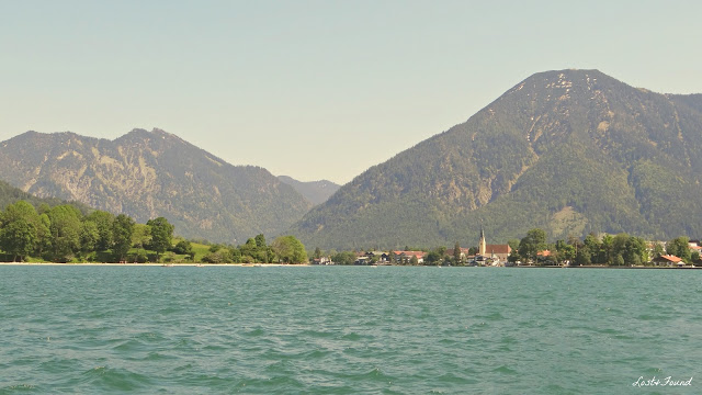 A large body of water with a mountain in the background