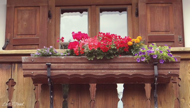 A vase of flowers sitting on top of a wooden door