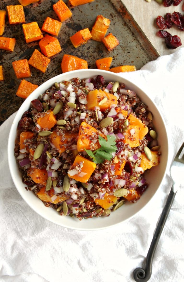 overhead image of bowl filled with Quinoa, Butternut Squash and Cranberry Salad with Balsamic Vinaigrette