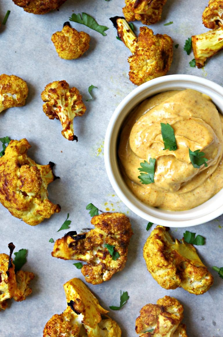 scattered Curried Oven Roasted Cauliflower with side dish of Curry Mayo