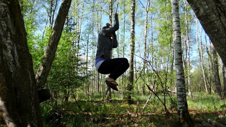 A man jumping in the forest