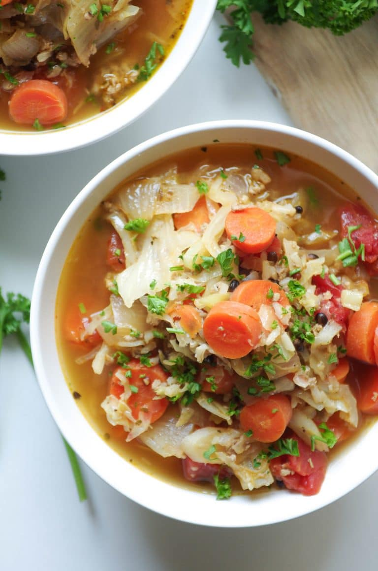 Russian Cabbage Soup with carrots and turkey in white bowl with parsley