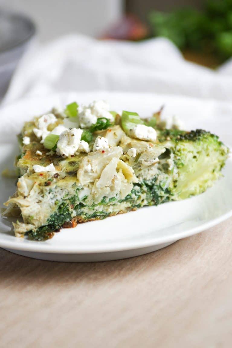 slice fo pan Broccoli, Spinach and Artichoke Frittata on plate