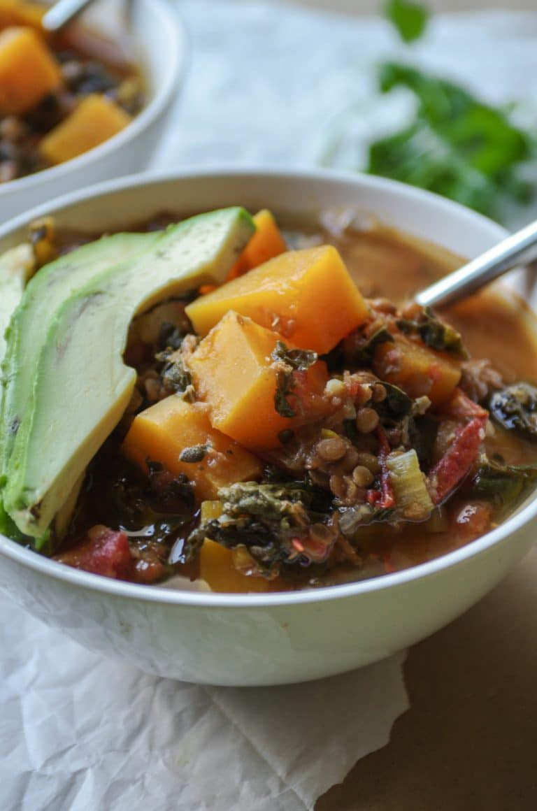 close up of bowl of Vegetarian Lentil Stew with Chipotle and Butternut Squash and avocado