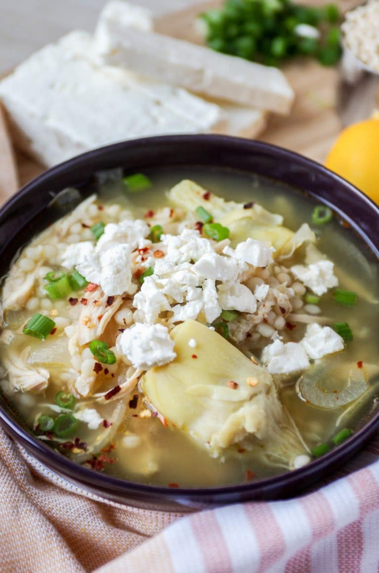 blue bowl filled with Greek Lemon Chicken Soup Recipe