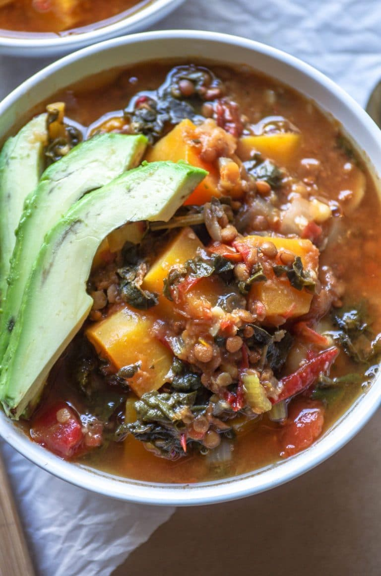 bowl of Vegetarian Lentil Stew with Chipotle and Butternut Squash and avocado