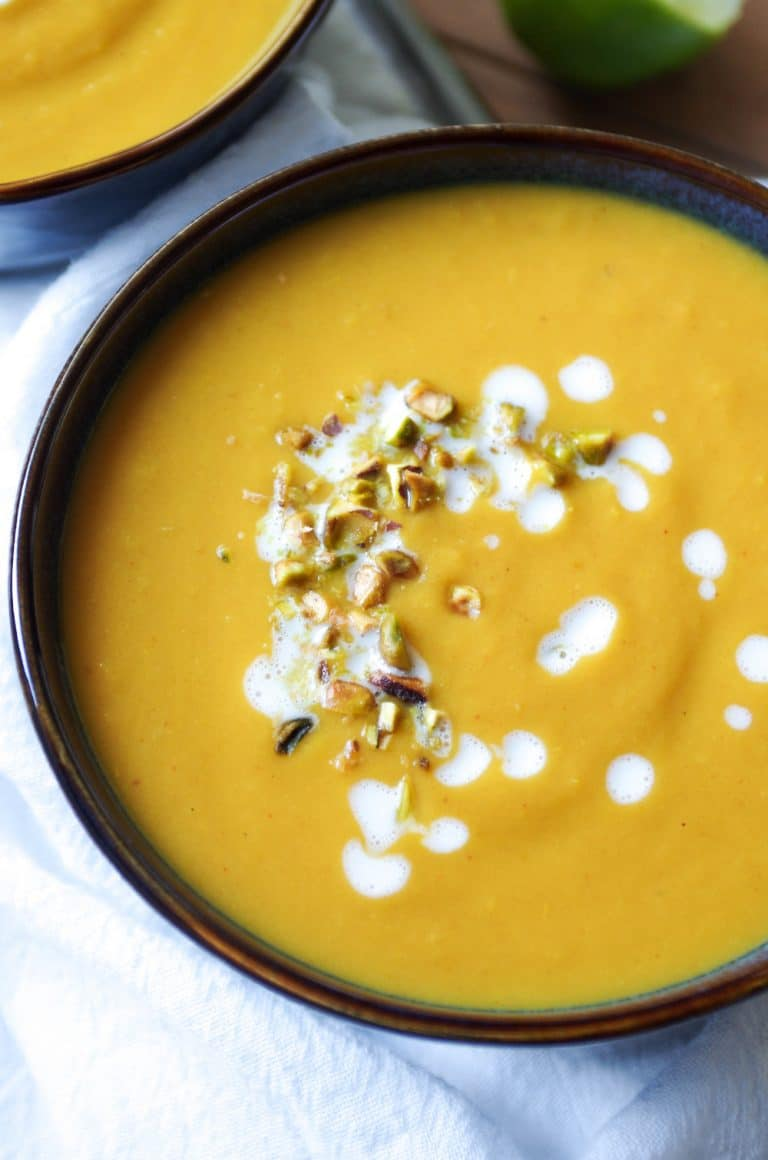 close up of two bowls of Thai Pumpkin and Sweet Potato Soup