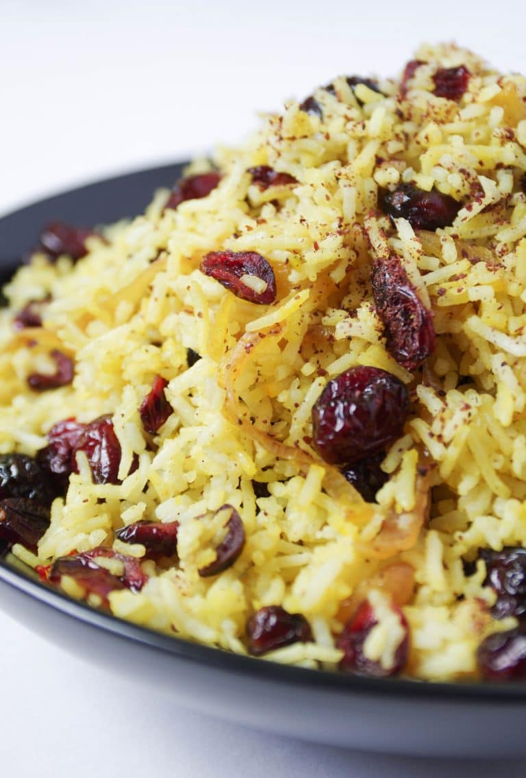 close up of plate of Persian Cranberry Rice Pilaf sprinkled with sumac