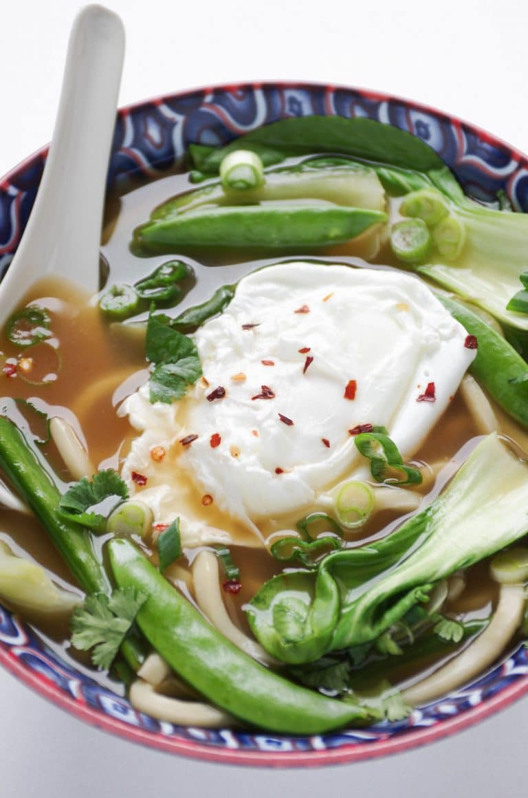 bowl of Udon Noodle Soup with Bok Choy and Poached Egg