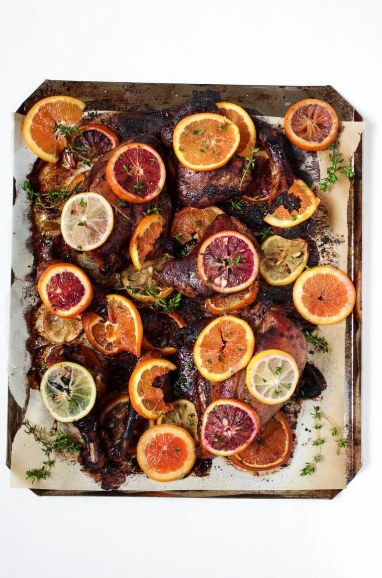 overhead image of sheet pan Oven Roasted Citrus Chicken with Pomegranate Molasses Marinade