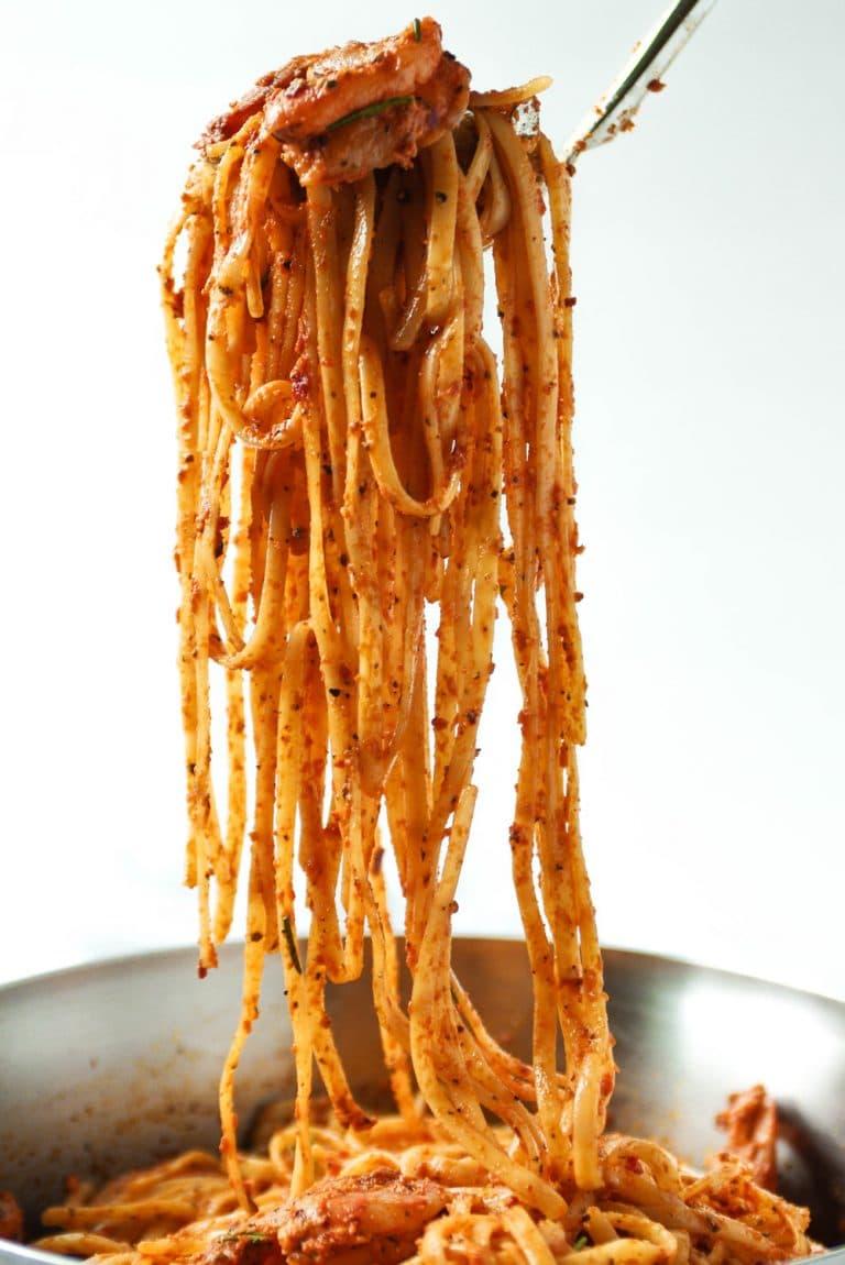 Sun Dried Tomato Basil Pesto Pasta with Shrimp on fork