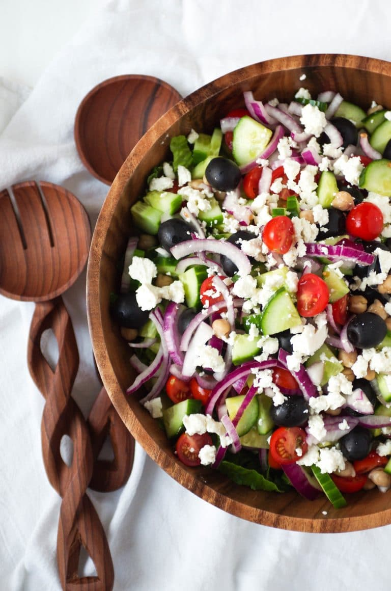 wooden bowl filled with Greek Salad