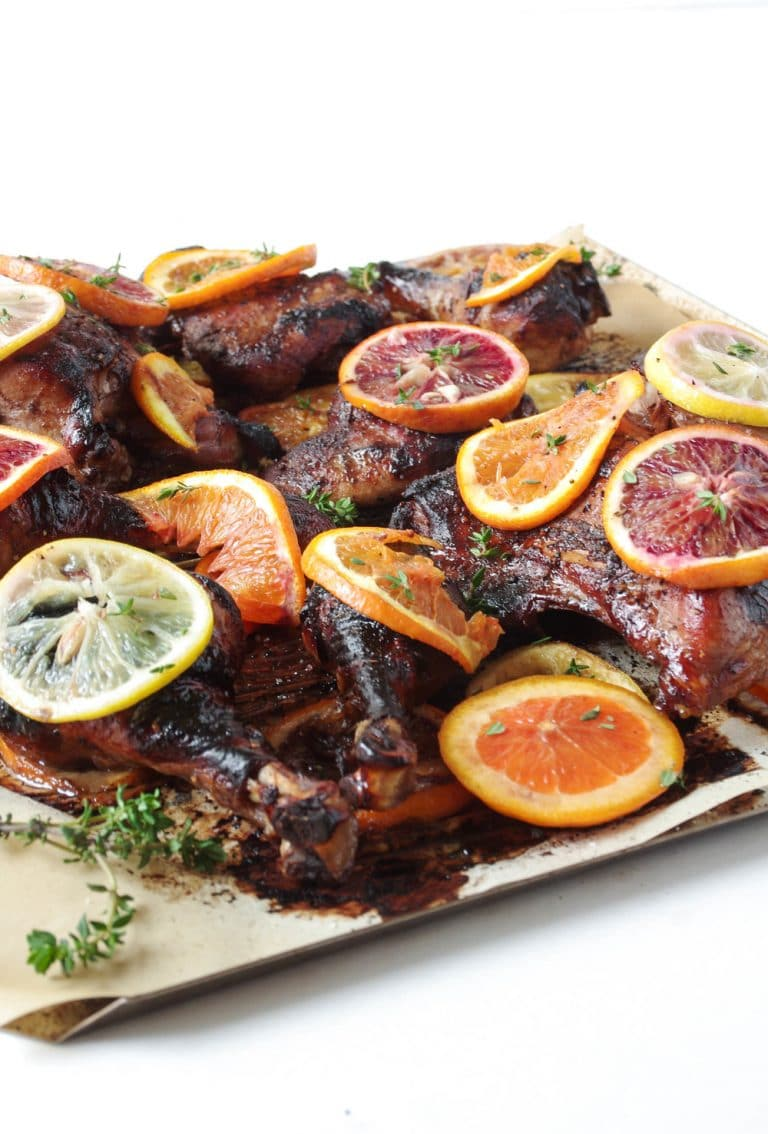 sheet pan filled with Oven Roasted Citrus Chicken with Pomegranate Molasses Marinade