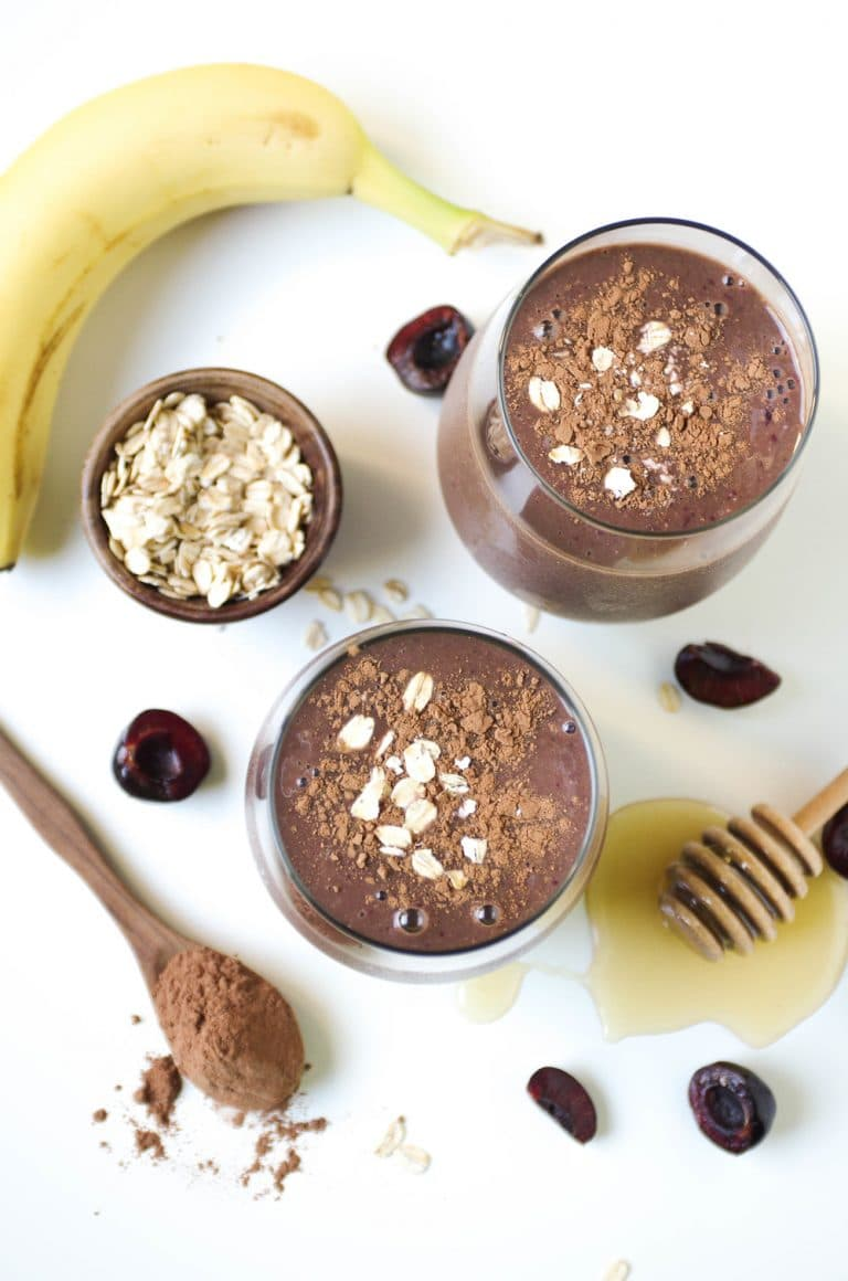overhead image of Cherry Cocoa Smoothie with ingredients scattered