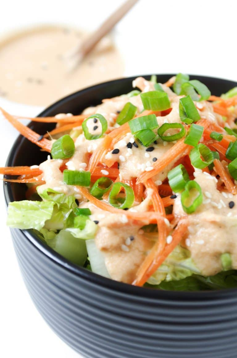 Japanese Garlic Ginger Salad Dressing on salad in bowl