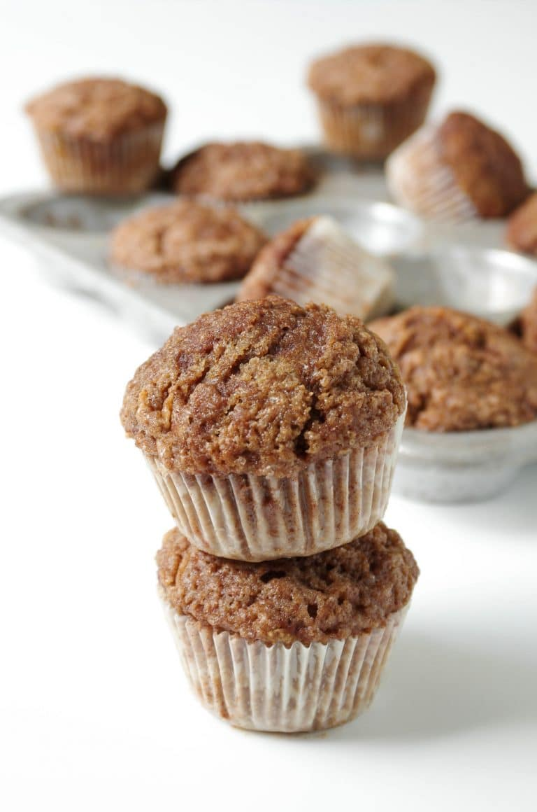 two stacked Healthier Cinnamon Apple Muffins with Cinnamon Sugar Topping