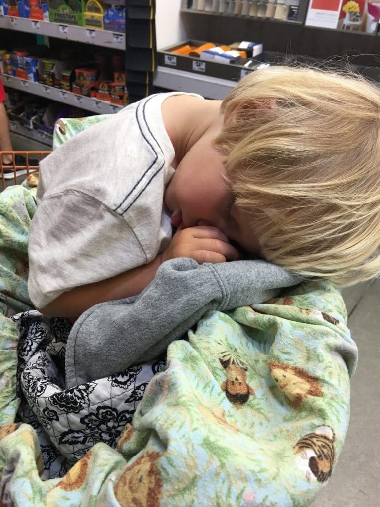 Boy sleeping at home depot