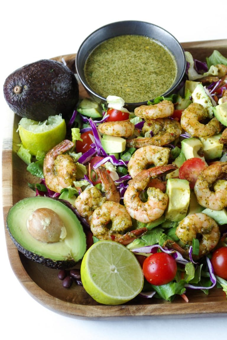 close up of platter full of Shrimp Avocado Salad with Cilantro Dressing in a side dish