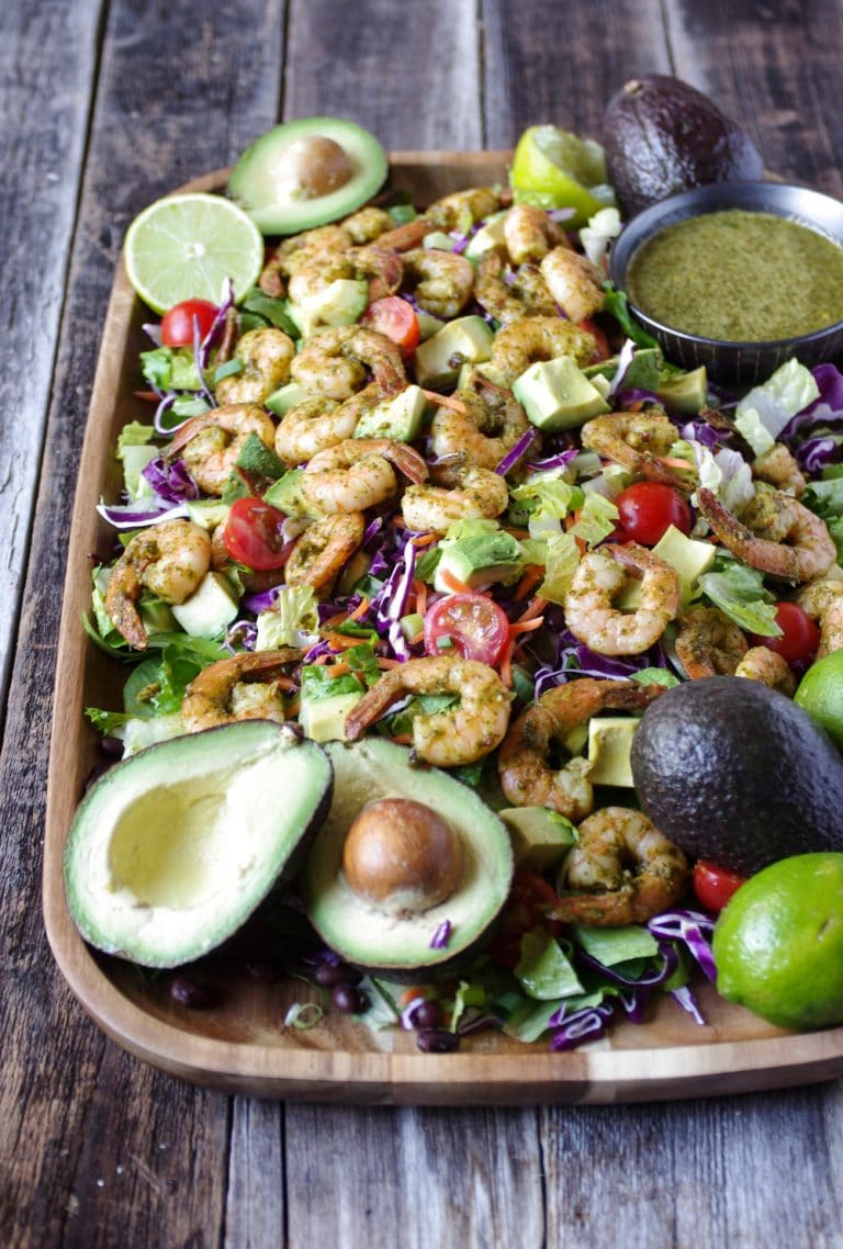 platter full of Shrimp Avocado Salad with Cilantro Dressing in a side dish