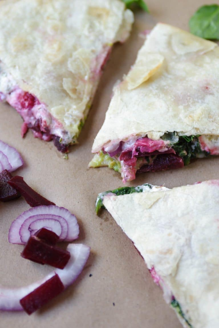cut Goat Cheese Quesadilla filled with Beet, Spinach and Raspberry and Avocado