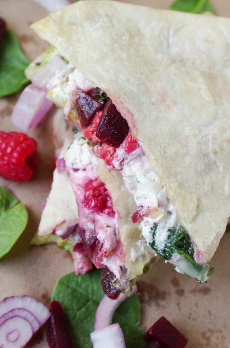 close up of stack of Goat Cheese Quesadilla filled with Beet, Spinach and Raspberry and Avocado