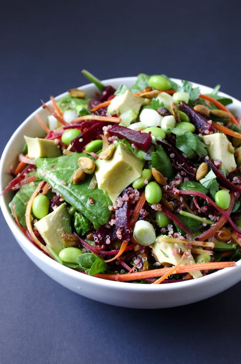 Beet Avocado Quinoa Salad in white bowl with Herb Vinaigrette
