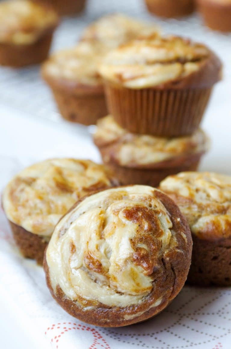 pile of Pumpkin Muffins with a Cream Cheese Swirl