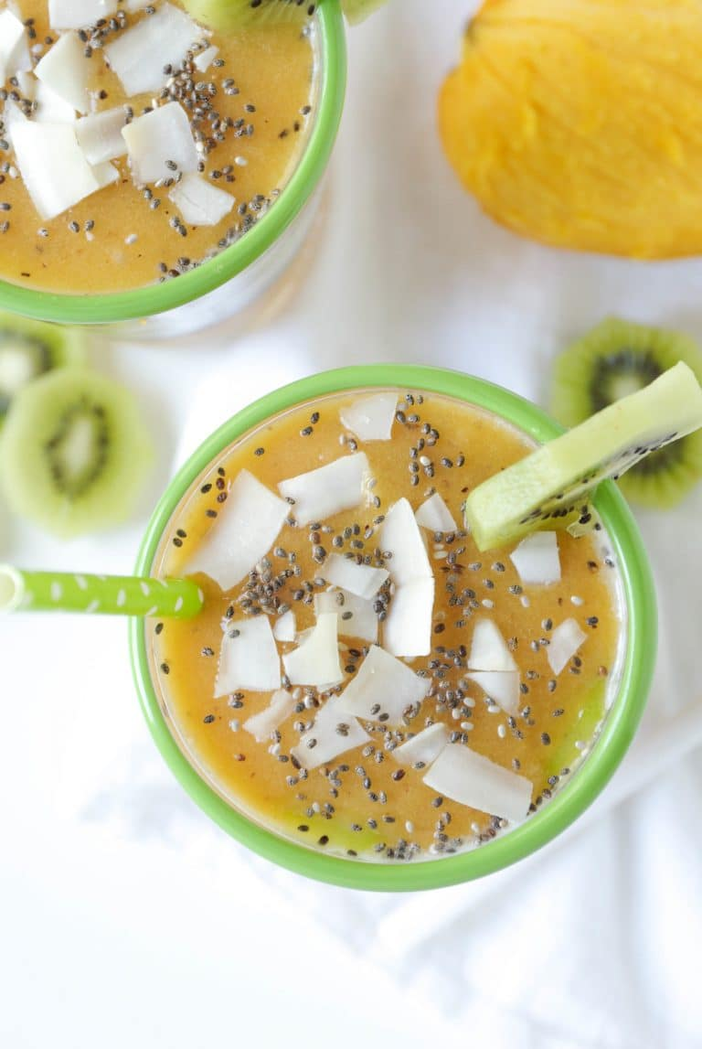 close up Chia Seed Pudding Cups with Mango, Peach and Kiwi slices