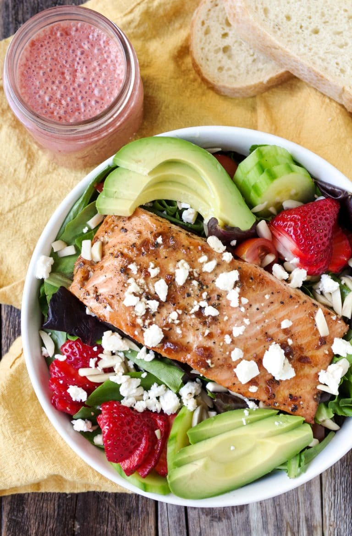 Teriyaki Salmon Salad in white bowl with Strawberry Vinaigrette in mason jar overhead