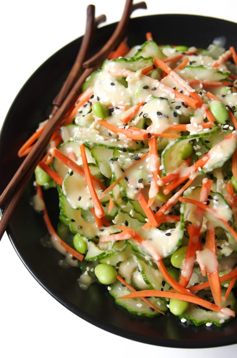 Cucumber Salad in black bowl with Easy Miso Dressing