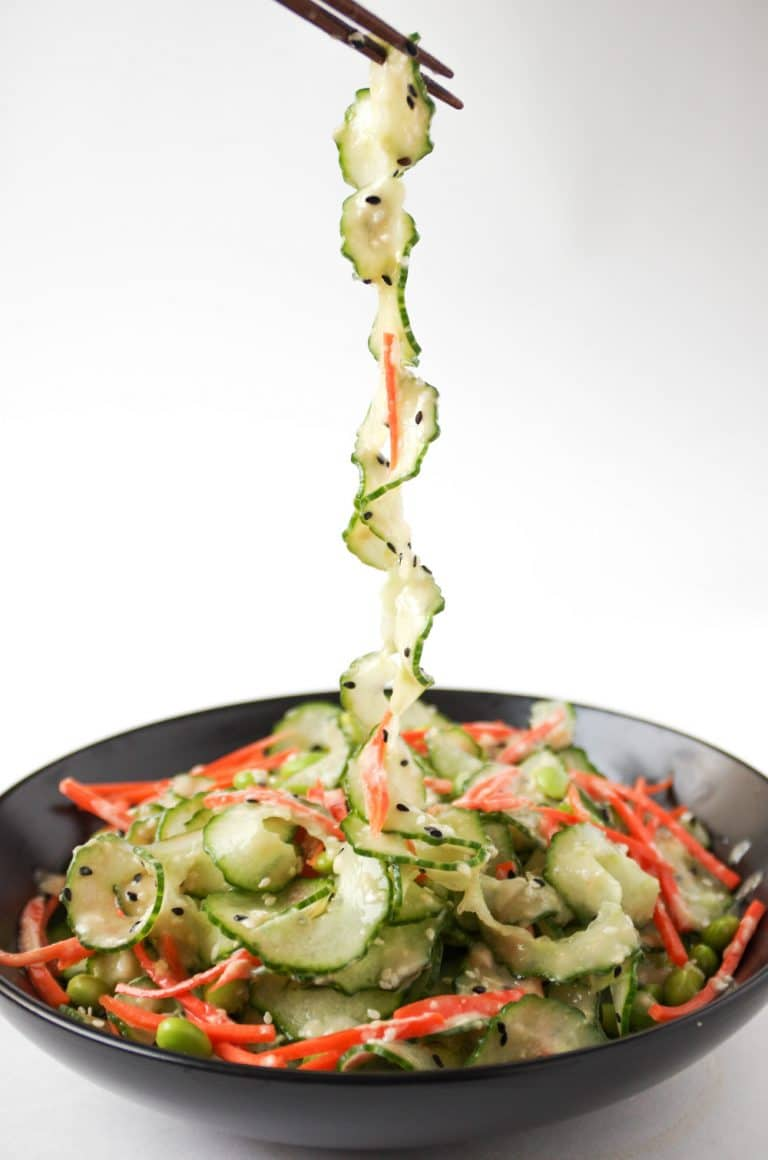 strand of cucumber being picked up from Cucumber Salad with Easy Miso Dressing