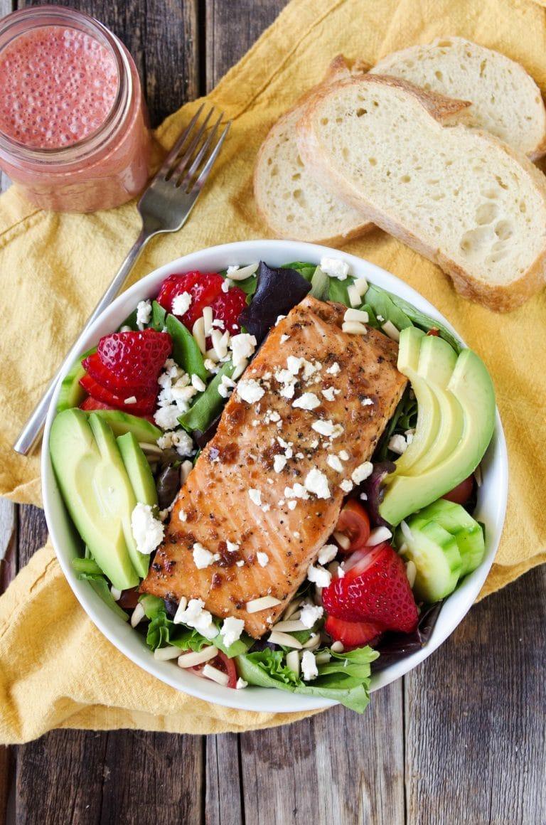 Teriyaki Salmon Salad in white bowl with Strawberry Vinaigrette in mason jar