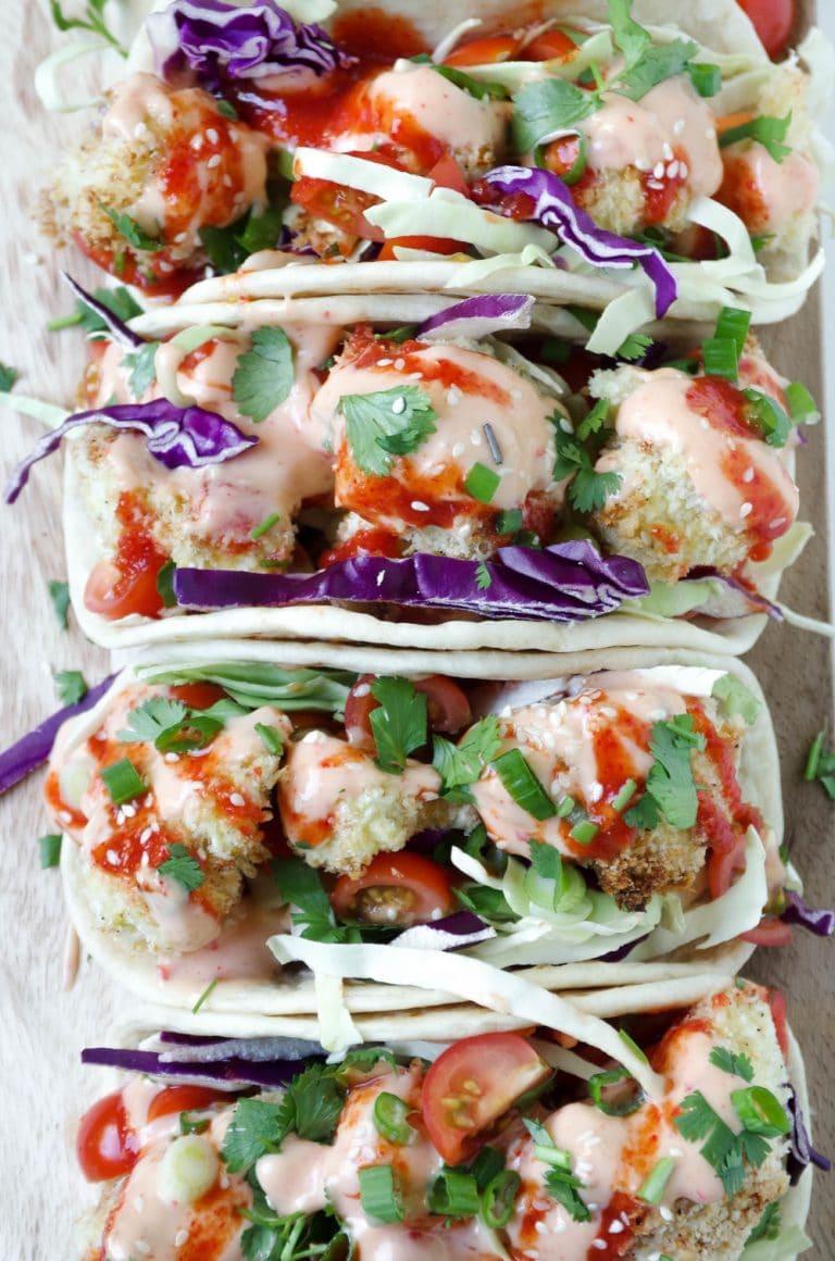 4 Baked Bang Bang Cauliflower Tacos in a row