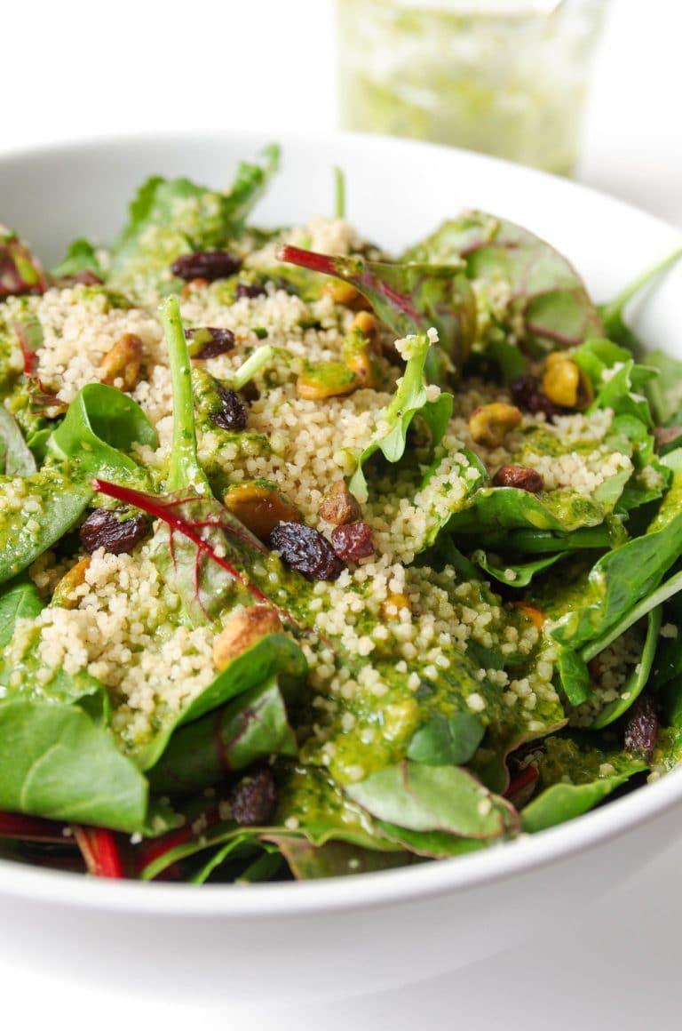 close up of Couscous Salad in white bowl with Cilantro Orange Vinaigrette