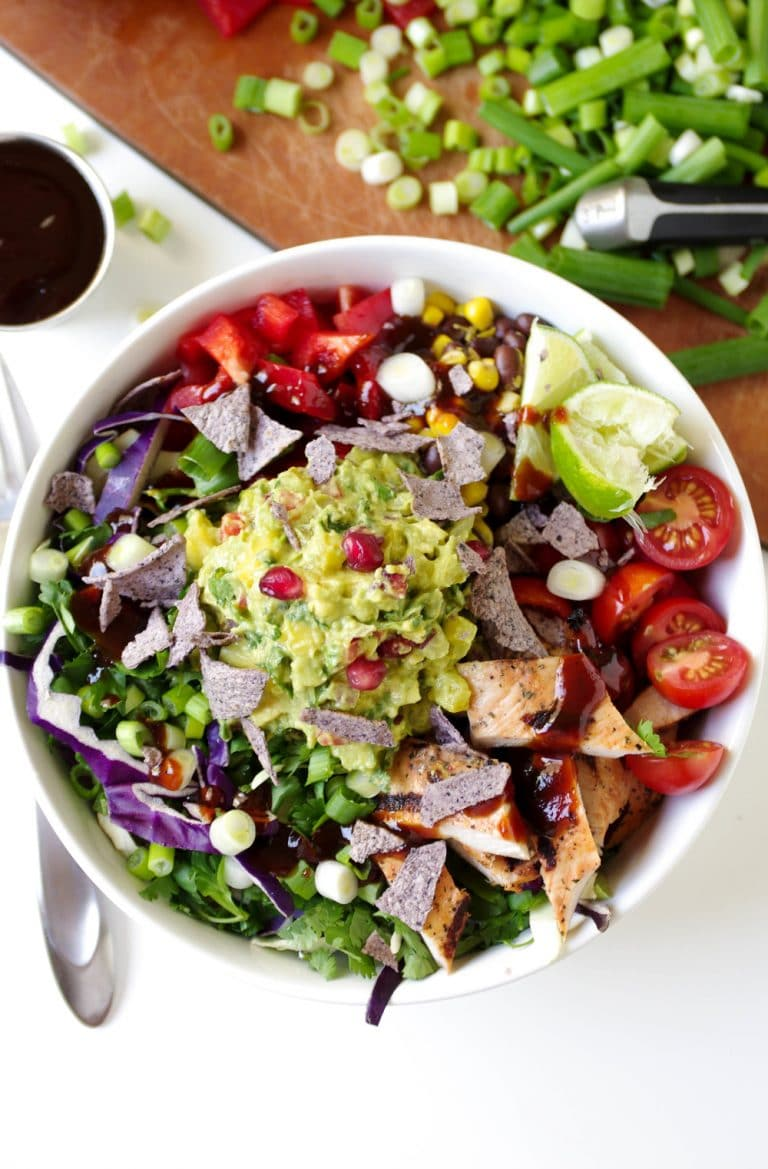 Southwestern Chicken Salad in white Bowl with Brown Rice and Guacamole