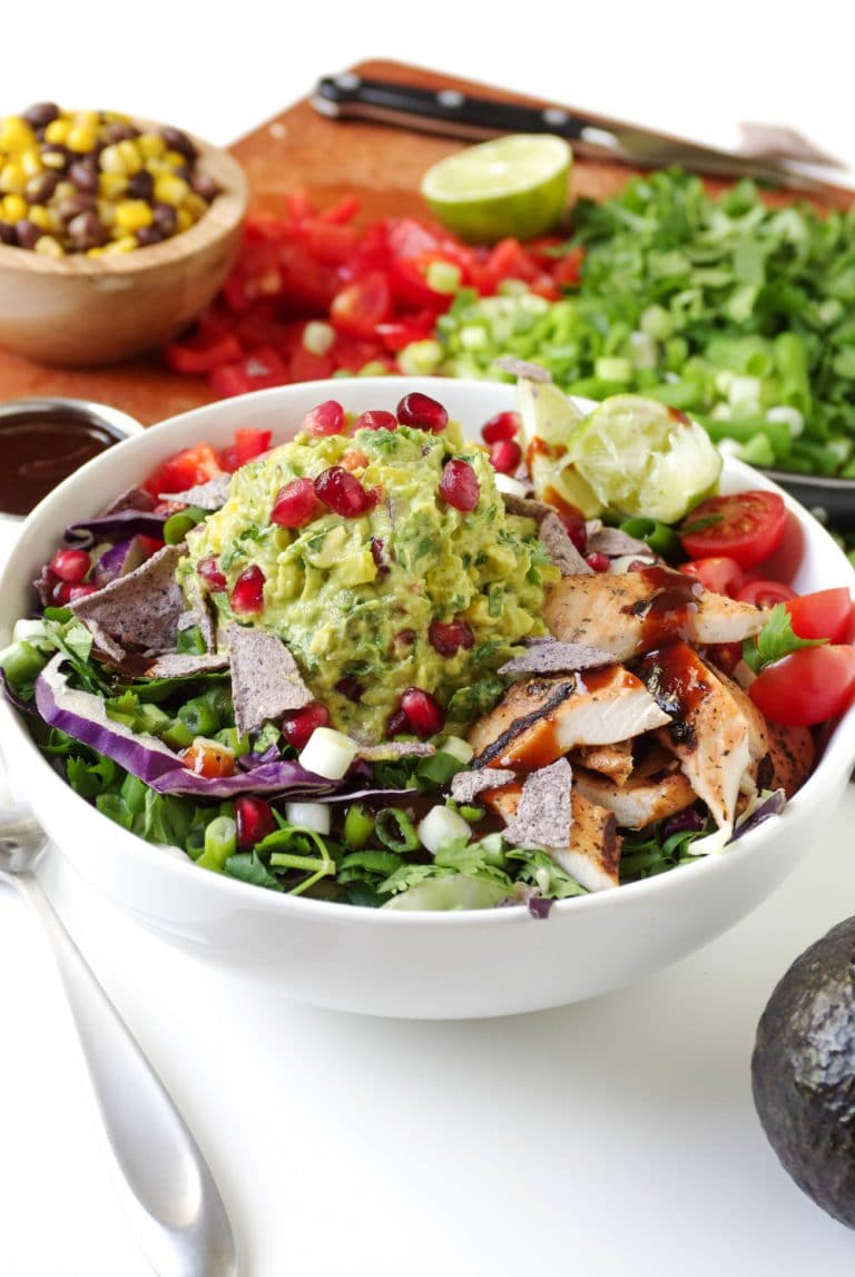 close up of Southwestern Chicken Salad in white Bowl with Brown Rice and Guacamole