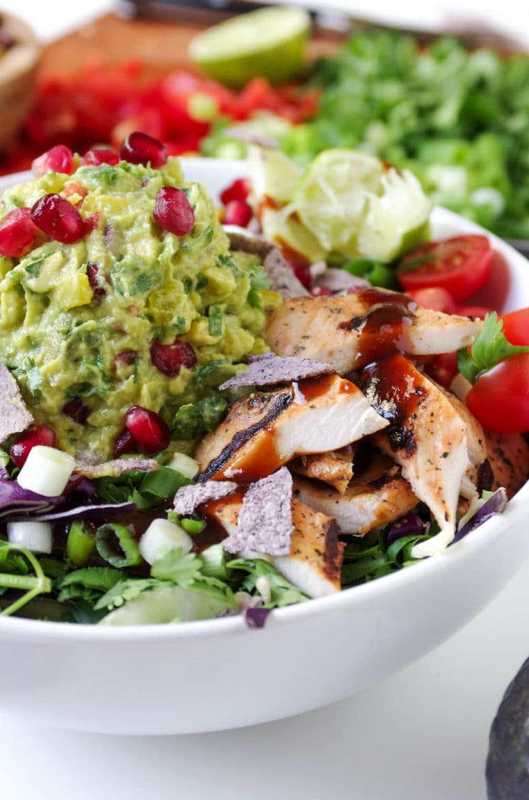 Southwestern Chicken in white Bowl with Brown Rice and Guacamole