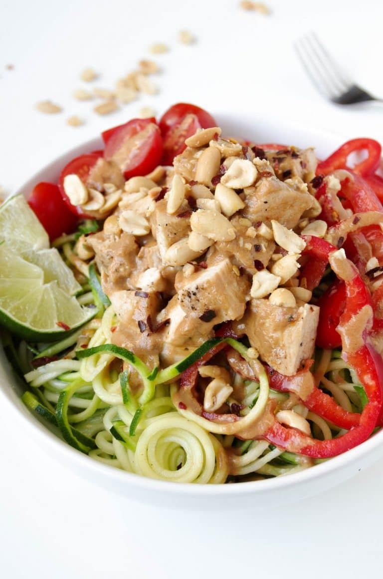Thai Chicken Zoodle Bowl with peanuts and tomatoes