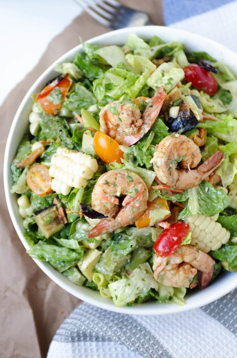 close up of Shrimp and veggie salad in white bowl with Avocado Cilantro Dressing