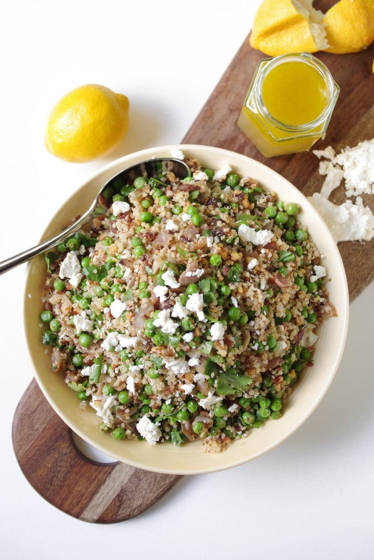 overhead image of Pea and Quinoa Salad with Lemon Honey Vinaigrette with open jar behind and lemons on side
