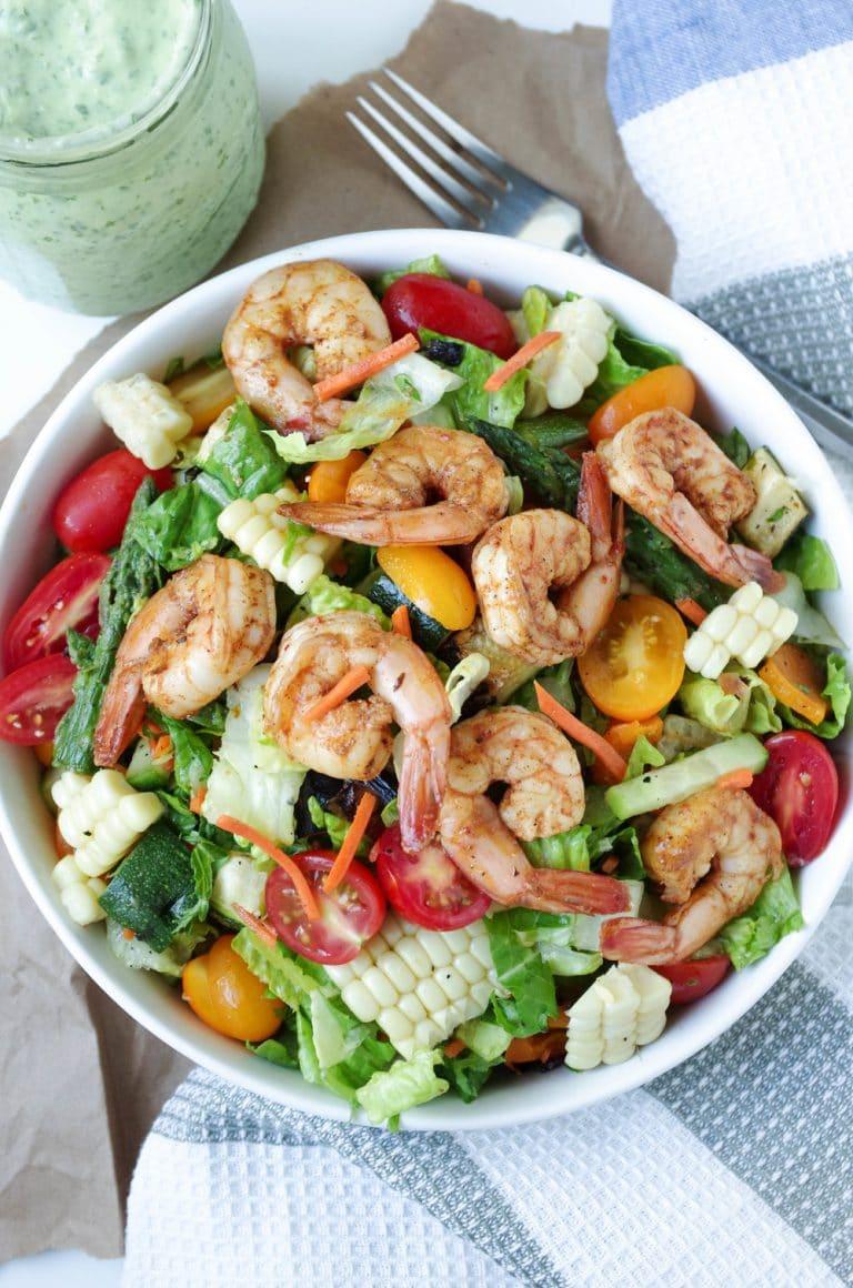 Shrimp and veggie salad in white bowl with Avocado Cilantro Dressing