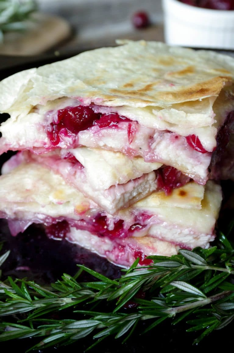quartered Leftover Cranberry and Turkey Quesadillas with Asiago and White Cheddar Cheese stacked up