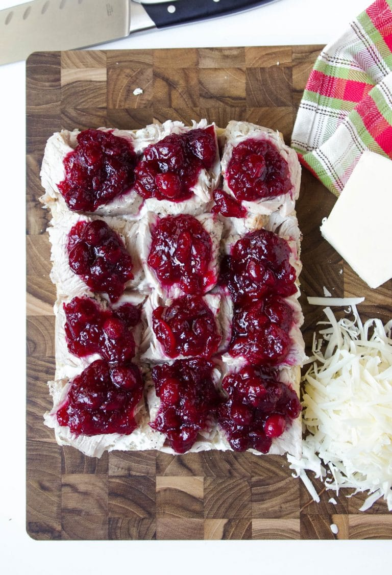 open face Leftover Turkey Cranberry Sliders with Asiago Cheese on side