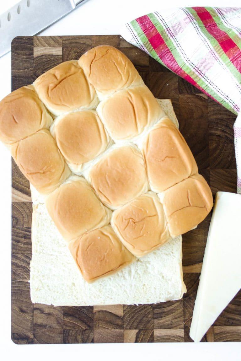 sheet of rolls cut in half on cutting board