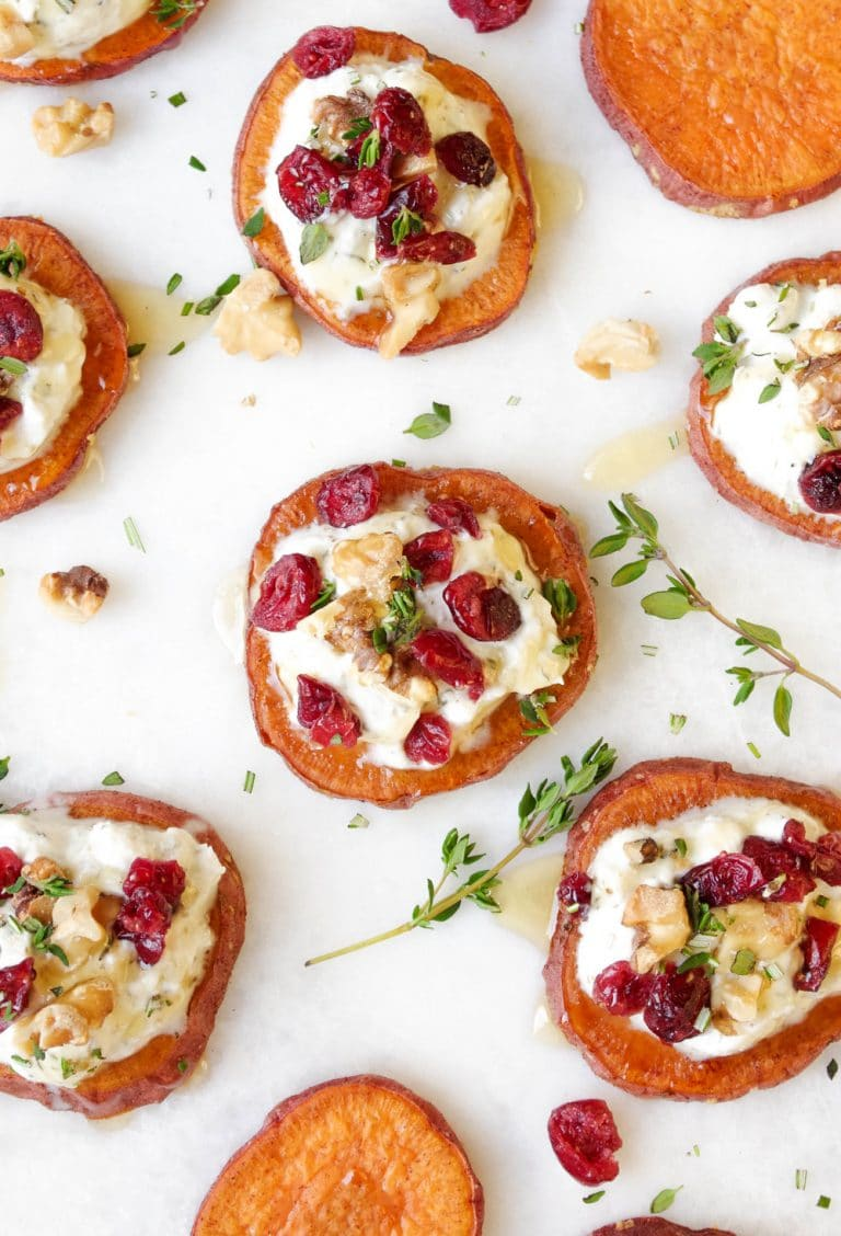 close up of Sweet Potato Rounds with Ricotta, Walnuts, Cranberries and Fresh Herbs