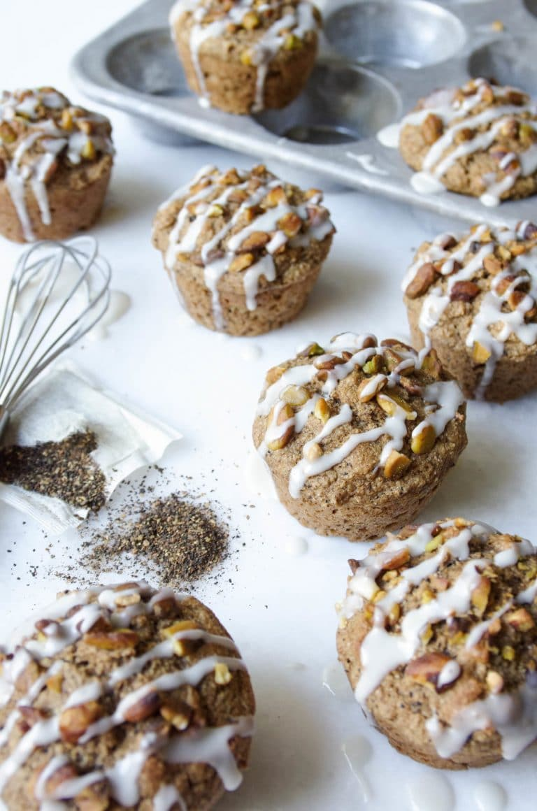 8 Pistachio Chai Muffins in front of muffin pan