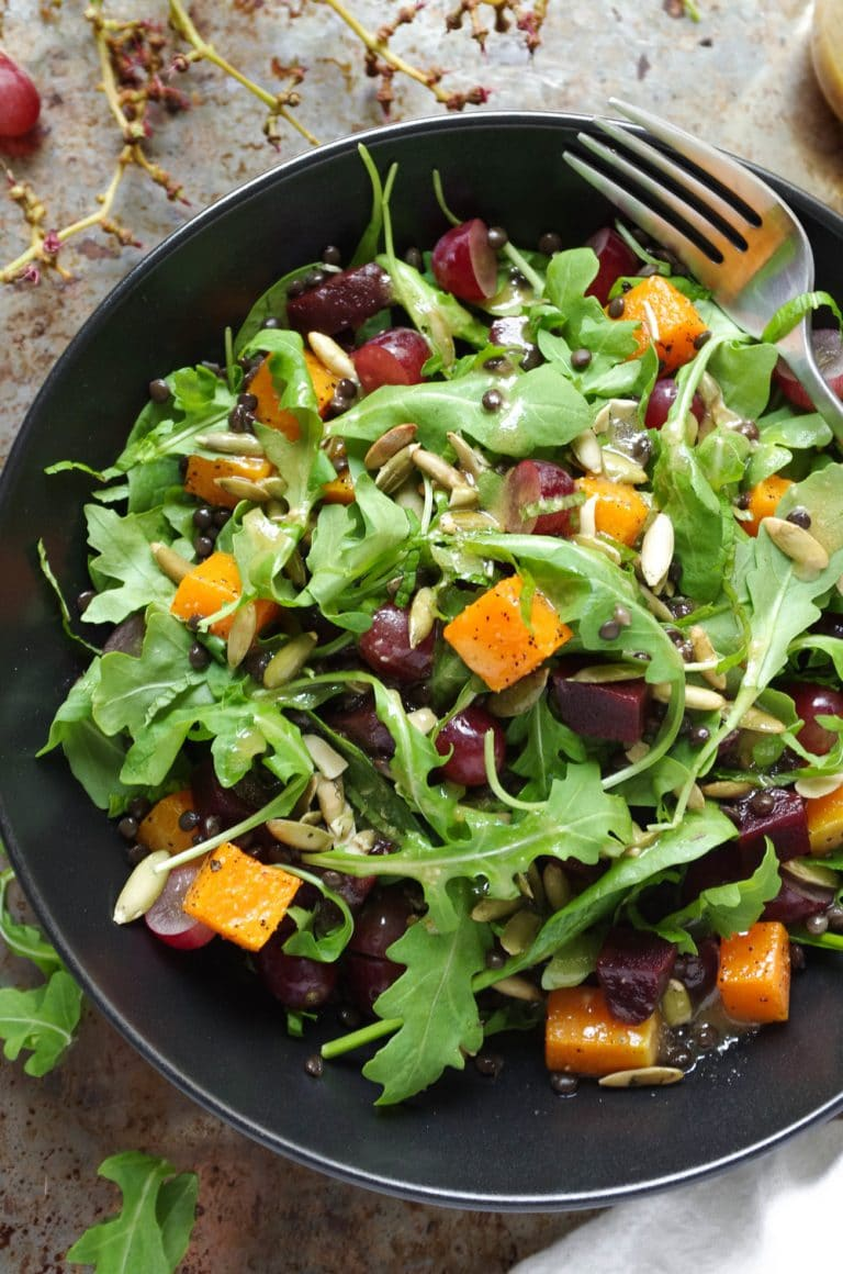 overhead image of Arugula Salad with Beluga Lentils, Butternut Squash and Grapes